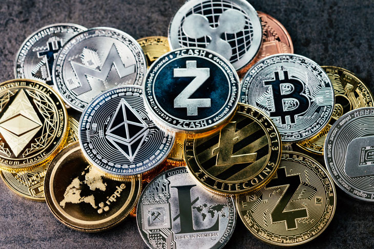 crypto currency background with various of shiny silver and golden physical cryptocurrencies symbol coins bitcoin ethereum litecoin zcash ripple stockpack adobe stock 1597x1065